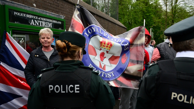 Loyalist protesters and police outside Antrim police station where Gerry Adams was being questioned