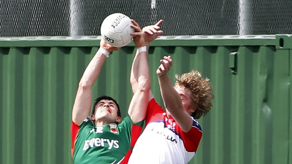 New York's Donal Vaughan with Ross Wherity of Mayo