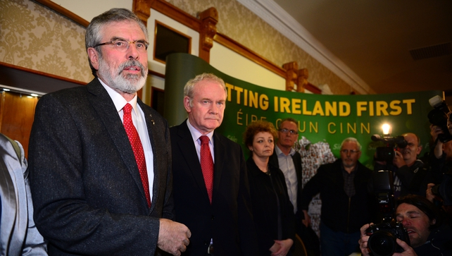 Gerry Adams and Martin McGuinness attending a press conference following his release from PSNI custody this evening