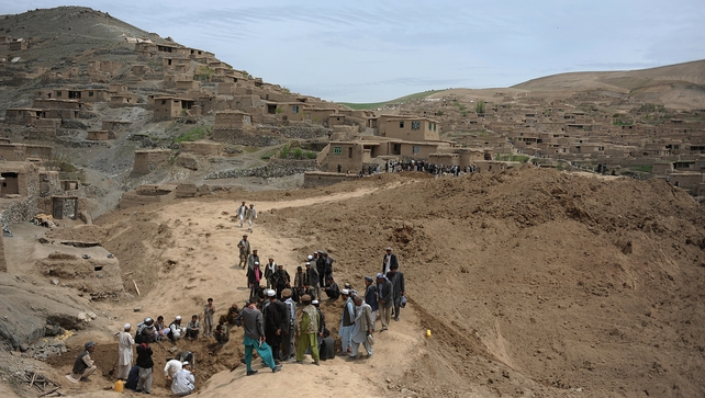 Afghan villagers affected by landslides look for survivors and victims in the Argo district of Badakhshan