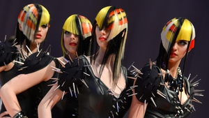 Models present hairstyles in the 'Progressive cut & style model' category of the women's competition of the World Hairdressing Championships in Frankfurt am Main, Germany