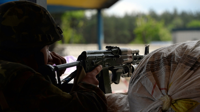 A Ukrainian soldier holds a position at a checkpoint near Slaviansk