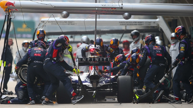 Daniel Ricciardo and Red Bull Racing make a pit stop during the Chinese Formula One Grand Prix