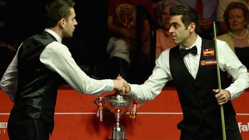 Ronnie O'Sullivan (right) lost the World Snooker Championship final to Mark Selby on Monday night