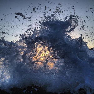 The sunset seen through waves in west Kerry (Pic: Seán Mac an tSíthigh)