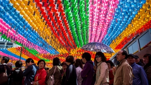 People queue to pay their respects underneath lines of lanterns after a ceremony celebrating Buddha's birth in Seoul, South Korea