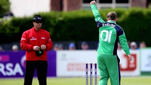 Ireland's Paul Stirling celebrates taking the wicket of Kithuruwan Vithanage