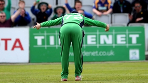 Ireland's Niall O'Brien celebrates after he hit the stumps to run out Angelo Mathews