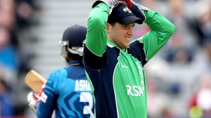 Ireland wicketkeeper Gary Wilson reacts to a missed chance