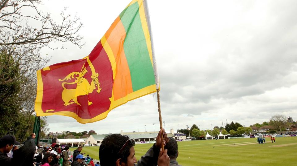 A Sri Lanka fan waves his flag
