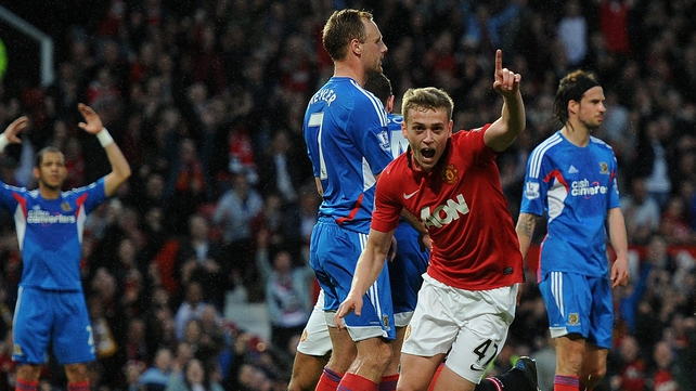 Manchester United's James Wilson celebrates after scoring his team's first goal