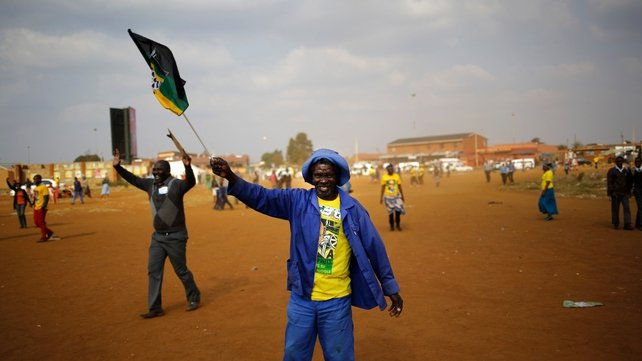 ANC supporters celebrate during a pre-election rally near Johannesburg