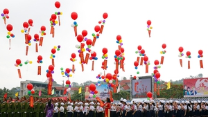 Vietnamese pupils release balloons during celebrations marking the 60th anniversary of the Dien Bien Phu victory