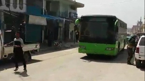 Buses left the besieged city with rebel fighters on board