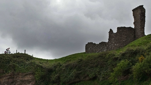 A cyclist rides along the Giro route at Red Bay Castle, Co Antrim