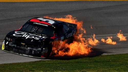 Flames are seen from the car of Kasey Kahne at the NASCAR Nationwide Series at Talladega Superspeedway