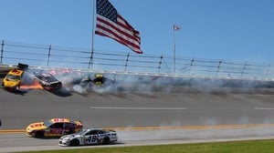 Competitors crash during the NASCAR Sprint Cup Series at Talladega Superspeedway