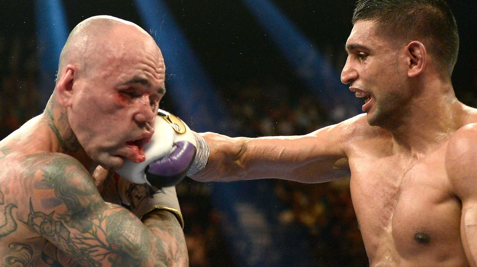 Amir Khan connects with a right on Luis Collazo during their welterweight bout in Las Vegas, Nevada