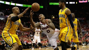 Jeff Teague of the Atlanta Hawks is fouled by the Indiana Pacers defence
