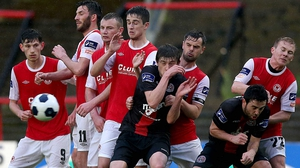 St Patrick's Athletic and Bohemians players face a free kick during their League Cup encounter at Dalymount