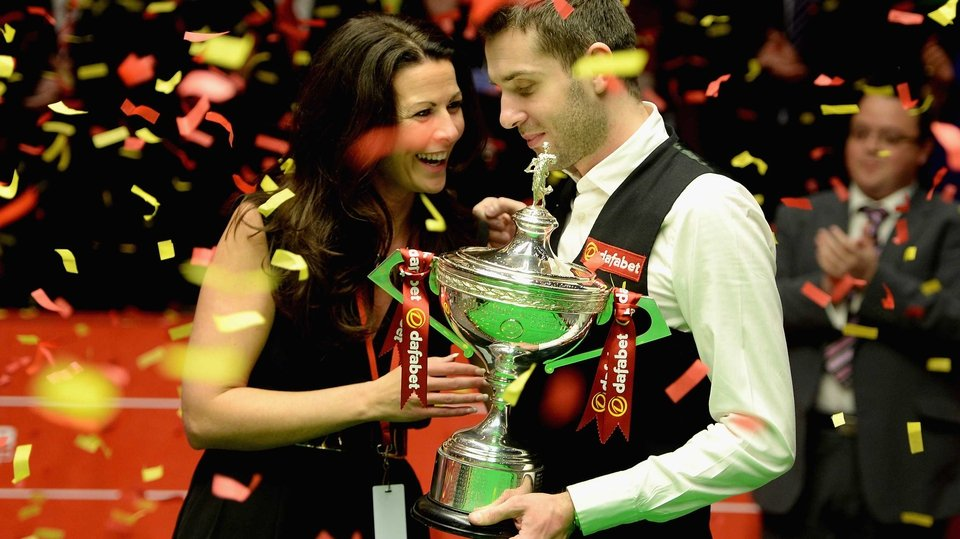 Mark Selby celebrates winning the World Snooker Championship title with his wife