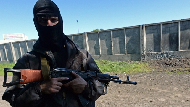 A pro-Russian fighter takes up position in the eastern town of Slaviansk