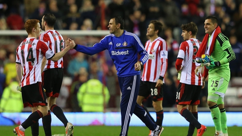 Gus Poyet celebrates with Jack Colback and his players after Sunderland seal safety with a win over West Brom