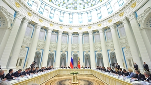 Vladimir Putin chairs a meeting in the Kremlin on the crisis in Ukraine
