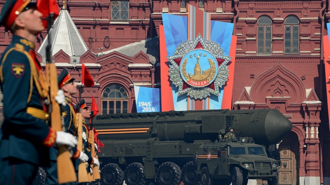 A Russian Topol-M intercontinental ballistic missile launcher forms part of the parade