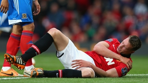 Phil Jones holds his shoulder during the match between Manchester United and Hull City
