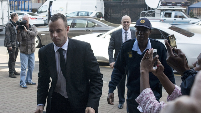 Oscar Pistorius arrives at his trial this morning