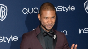 Usher is collaborating with Chris Brown