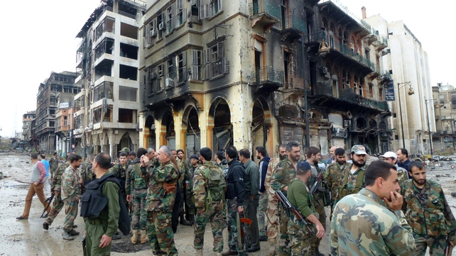 Government forces gather in Homs after the negotiated withdrawal of rebel fighters