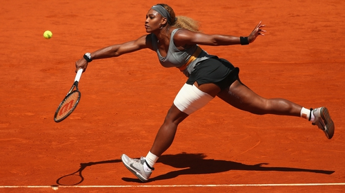 Serena Williams stretches to play a forehand against Carla Suarez Navarro in the third round of the Madrid Open