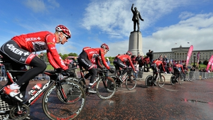 Team USA pass the statue of Edward Carson as they enter the Stormont estate during a practice session on Friday