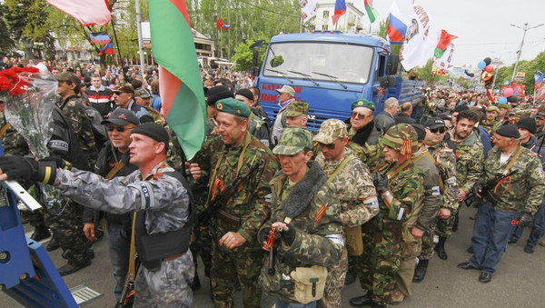 Armed supporters of the self-declared Donetsk People's Republic depart for Mariupol to help to separatists fighting with Ukrainian National Guard forces