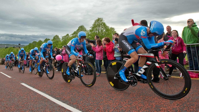 The Garmin-Sharp team tackle the Stormont hill ahead of the crash