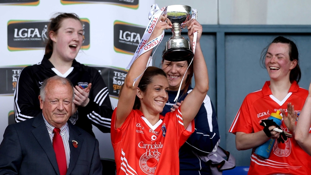 Caitlin Malone lifts the trophy after Armagh won the Ladies NFL Division 3 title