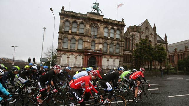 The peloton makes its way past an Orange Hall on Clifton Street early on stage two of the 2014 Giro d'Italia in Belfast