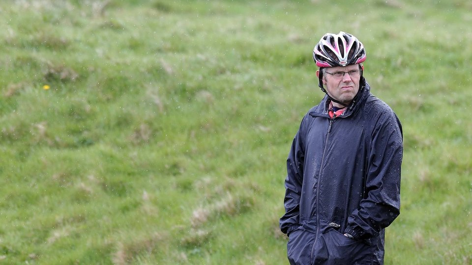A particuarly careful spectator waits for the Giro riders to pass by Dunluce Castle on Saturday