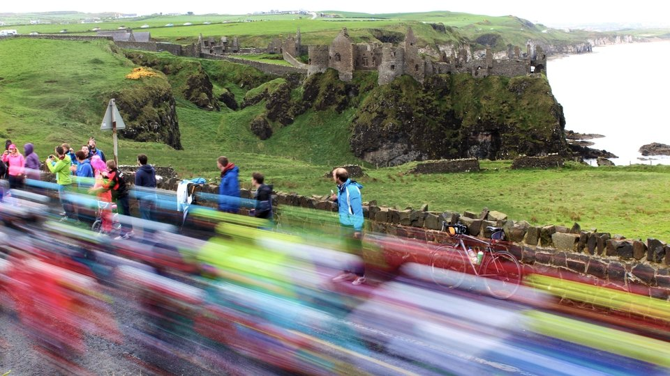 Giro d'Italia riders traveling past Dunluce Castle