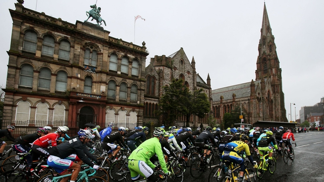 The peloton makes it's way past Orange Hall and Carlisle memorial church on Clifton Street in Belfast.