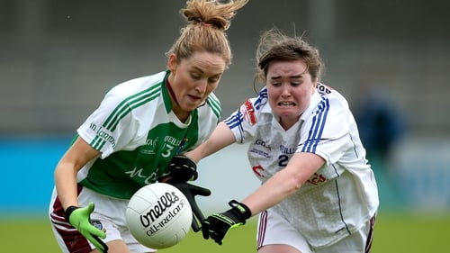 Fiona Leavy of Westmeath and Galway's Nicola Ward (R) battle for possession