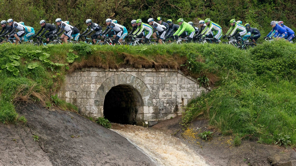 The Giro d'Italia riders pass along the Antrim coast on Saturday