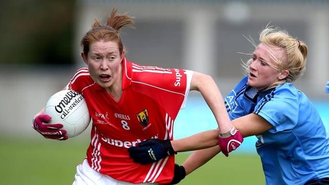 Dublin's Rachel Ruddy (R) tries to get to grips with Cork's Rena Buckley