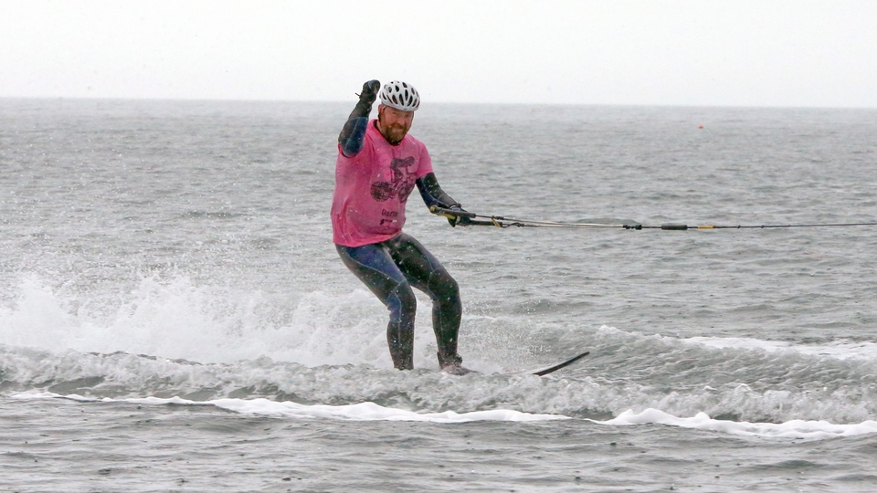 Cushendall man Marty McGarry follows the Giro d'Italia Peloton on a water-ski as it travels along the North Antrim Coast on Saturday