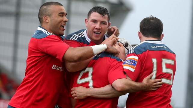 Munster's Duncan Williams (number 9) is congratulated for his try by Felix Jones, Simon Zebo and Paddy Butler