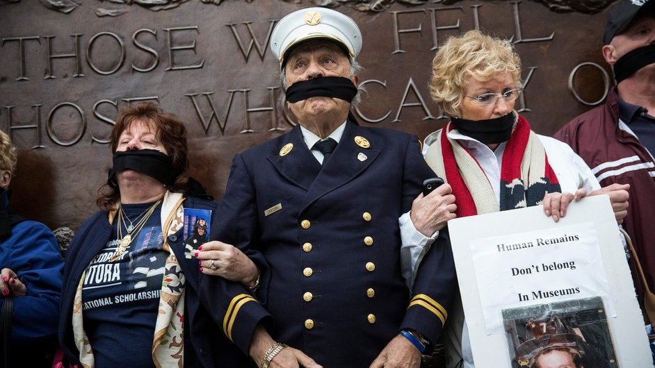 Al Santora (C), father of Christopher Santora, a victim of the September 11, 2001 attack, and other victim's family members protest the decision by city officials to keep unidentified human remains of the 9-11 victims at the 9-11 Museum at the World Trade