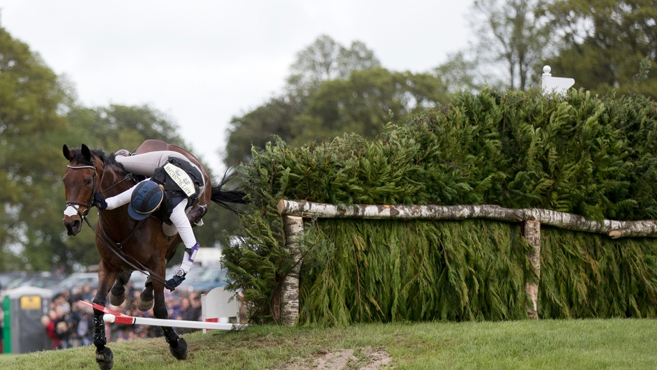 Canadian rider Rebecca Howard falls from her horse 'Riddle Master' at the Mirage Pond jump of the Cross County discipline on the penultimate day of the Badminton Horse Trials