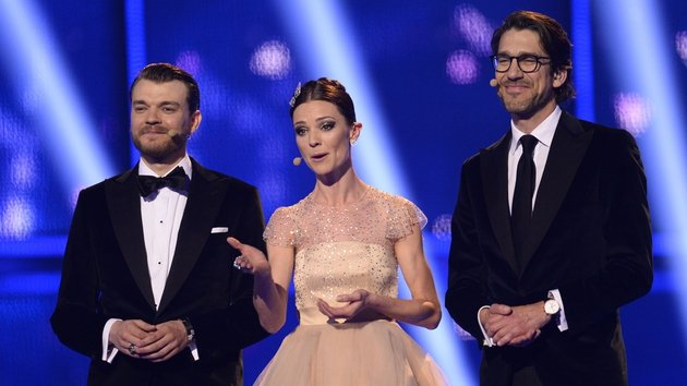 Tonight's presenters Danish musician Nikolaj Koppel, Danish television presenter Lise Roenne and Danish actor Pilou Asbaek